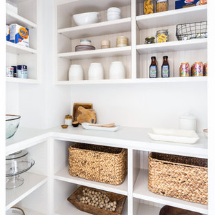Mid-sized country l-shaped kitchen pantry in Los Angeles with open cabinets, white cabinets, multi-coloured floor and white benchtop.