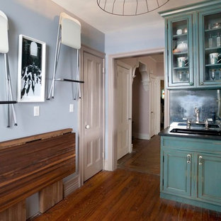 Eclectic kitchen designs - Inspiration for an eclectic kitchen remodel in New York with stainless steel appliances