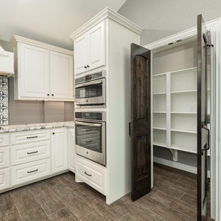 Large farmhouse kitchen pantry inspiration - Example of a large cottage single-wall ceramic tile and brown floor kitchen pantry design in Houston with a farmhouse sink, raised-panel cabinets, dark wood cabinets, granite countertops, gray backsplash, wood backsplash, stainless steel appliances, an island and gray countertops