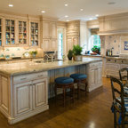 Traditional Kitchen With Natural Wood Island And White