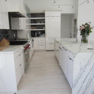 Coastal kitchen designs - Beach style kitchen photo in New York