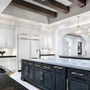 Transitional eat-in kitchen ideas - Example of a transitional l-shaped eat-in kitchen design in Austin with an undermount sink, raised-panel cabinets, black cabinets, white backsplash, two islands and white countertops