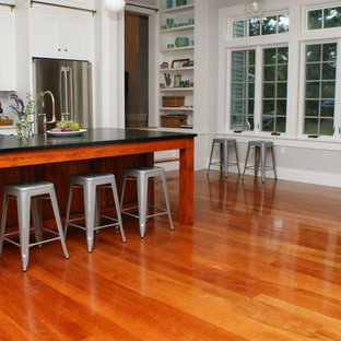 Kitchen - contemporary medium tone wood floor kitchen idea in Providence with stainless steel appliances and an island