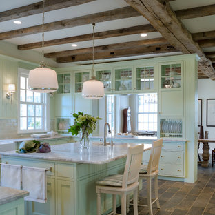 Farmhouse eat-in kitchen ideas - Inspiration for a country u-shaped eat-in kitchen remodel in DC Metro with a farmhouse sink, glass-front cabinets, green cabinets, marble countertops, beige backsplash, subway tile backsplash and stainless steel appliances