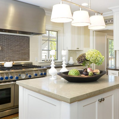 Inspiration for a contemporary enclosed kitchen remodel in San Francisco with stainless steel appliances, recessed-panel cabinets, white cabinets, multicolored backsplash and matchstick tile backsplash