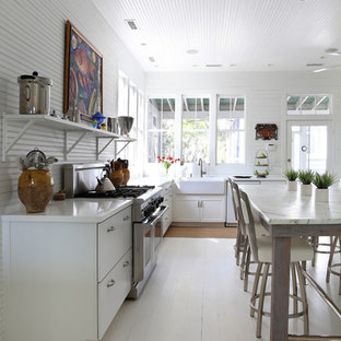Design ideas for a beach style kitchen in San Francisco with a farmhouse sink, painted wood floors and white floor.