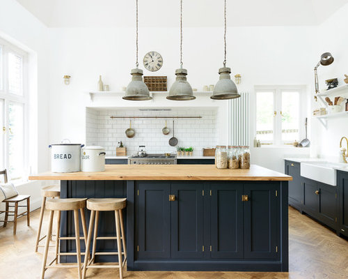 Transitional Medium Tone Wood Floor Kitchen Photo In Other With A Farmhouse  Sink, Shaker Cabinets