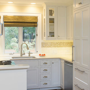 Inspiration for a small classic u-shaped kitchen/diner in Raleigh with a submerged sink, recessed-panel cabinets, white cabinets, engineered stone countertops, white splashback, metro tiled splashback, stainless steel appliances, dark hardwood flooring, no island, brown floors and beige worktops.