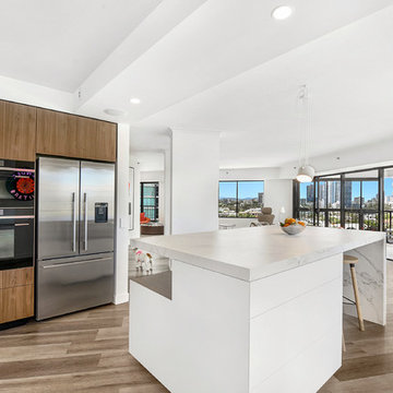 An entertainer's kitchen with two ovens and a workbench for more than one cook