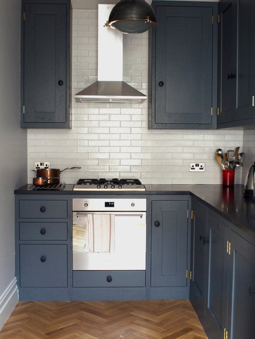 Inspiration for a small contemporary l-shaped medium tone wood floor  enclosed kitchen remodel in