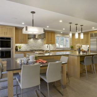 Large transitional open concept kitchen appliance - Example of a large transitional l-shaped porcelain floor and gray floor open concept kitchen design in New York with an undermount sink, shaker cabinets, medium tone wood cabinets, granite countertops, multicolored backsplash, glass tile backsplash, stainless steel appliances and an island