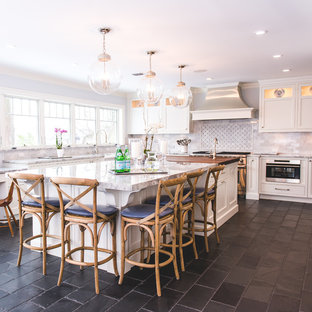 Large farmhouse eat-in kitchen designs - Eat-in kitchen - large farmhouse u-shaped slate floor and black floor eat-in kitchen idea in New York with an island, an undermount sink, recessed-panel cabinets, white cabinets, quartz countertops, gray backsplash, marble backsplash and stainless steel appliances