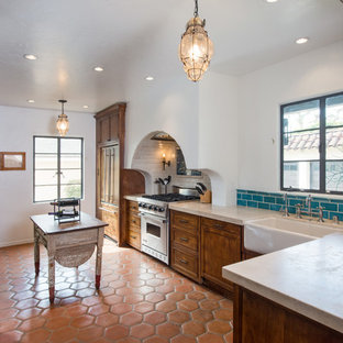 Tuscan kitchen photo in Miami with a farmhouse sink, medium tone wood cabinets and blue backsplash
