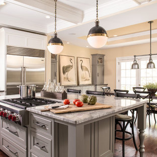 Inspiration for a transitional dark wood floor eat-in kitchen remodel in Atlanta with beaded inset cabinets, gray cabinets, white backsplash, stainless steel appliances and an island