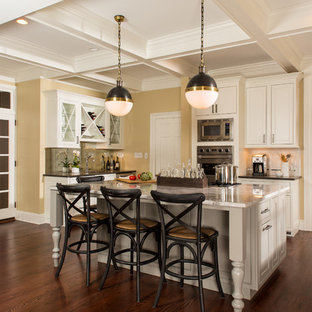 Kitchen - transitional dark wood floor kitchen idea in Atlanta with beaded inset cabinets, white cabinets, white backsplash, stainless steel appliances and an island