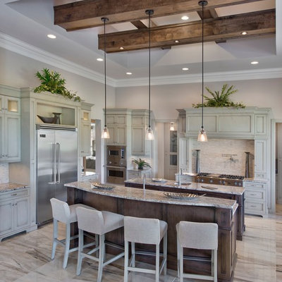 Open concept kitchen - huge mediterranean l-shaped multicolored floor open concept kitchen idea in Miami with an undermount sink, recessed-panel cabinets, gray cabinets, white backsplash, mosaic tile backsplash, two islands and stainless steel appliances