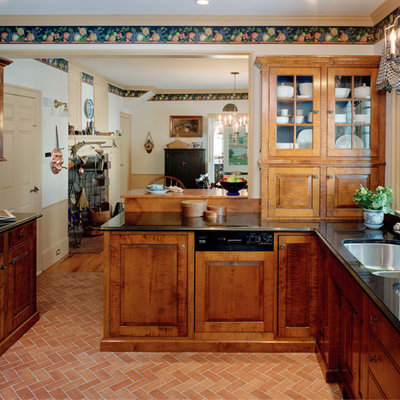 Eat-in kitchen - mid-sized traditional terra-cotta tile eat-in kitchen idea in Boston with a double-bowl sink, raised-panel cabinets, medium tone wood cabinets, granite countertops and stainless steel appliances