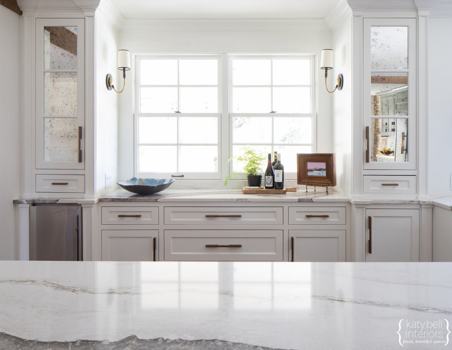 Antiqued Mirror Inserts, Upper Cabinetry symmetry, Cambria Countertop, Fresh whi