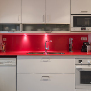Small contemporary enclosed kitchen designs - Inspiration for a small contemporary single-wall enclosed kitchen remodel in Barcelona with a double-bowl sink, flat-panel cabinets, white cabinets, red backsplash, white appliances and no island