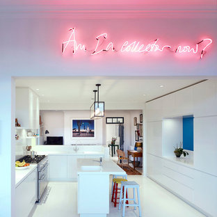 Contemporary kitchen designs - Inspiration for a contemporary u-shaped kitchen remodel in London with a single-bowl sink, flat-panel cabinets, white cabinets and an island
