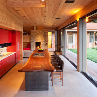 Mid-sized modern single-wall eat-in kitchen in San Francisco with red cabinets, panelled appliances, a drop-in sink, beige splashback and with island.