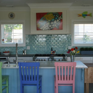Inspiration for a mid-sized eclectic l-shaped open plan kitchen with an undermount sink, shaker cabinets, white cabinets, concrete benchtops, blue splashback, ceramic splashback, stainless steel appliances, ceramic floors, with island and grey floor.