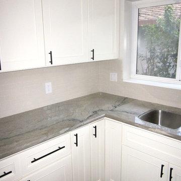Aquarelle Counter with White Subway Tile Kitchen