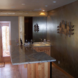 Rustic kitchen ideas - Example of a mountain style kitchen design in Phoenix