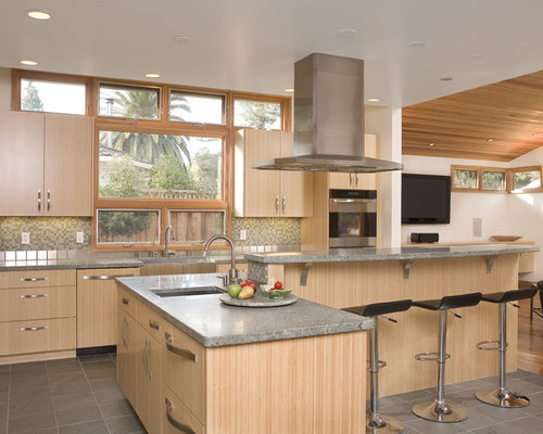 Contemporary u-shaped kitchen idea in San Francisco with mosaic tile  backsplash, stainless steel
