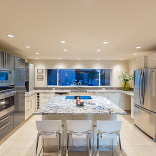 Example of a large trendy u-shaped porcelain floor open concept kitchen design in Vancouver with an undermount sink, flat-panel cabinets, white cabinets, stainless steel appliances, granite countertops, multicolored backsplash, mosaic tile backsplash and an island