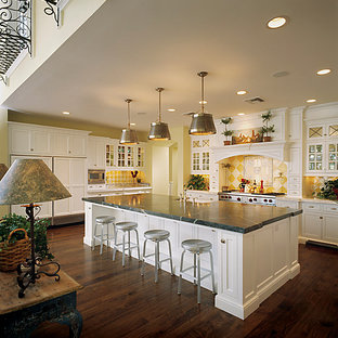 Large traditional open concept kitchen ideas - Open concept kitchen - large traditional u-shaped medium tone wood floor open concept kitchen idea in Phoenix with recessed-panel cabinets, white cabinets, marble countertops, yellow backsplash, ceramic backsplash, stainless steel appliances and an island