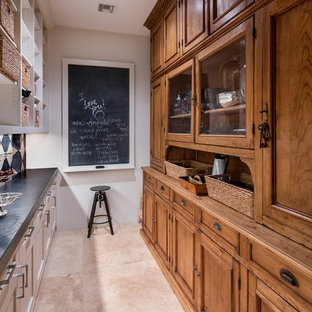 Traditional kitchen pantry designs - Inspiration for a timeless galley beige floor kitchen pantry remodel in Phoenix with recessed-panel cabinets, medium tone wood cabinets, white backsplash and gray countertops
