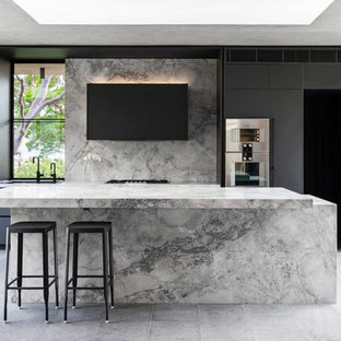 Inspiration for a large contemporary galley kitchen in Sydney with an undermount sink, black cabinets, marble benchtops, grey splashback, marble splashback, stainless steel appliances, with island, grey floor, grey benchtop and flat-panel cabinets.