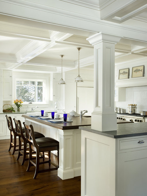 Example of a classic kitchen design in Boston with recessed-panel cabinets,  white cabinets