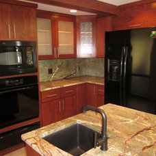 Contemporary Kitchen by Hickory Builders, Inc.