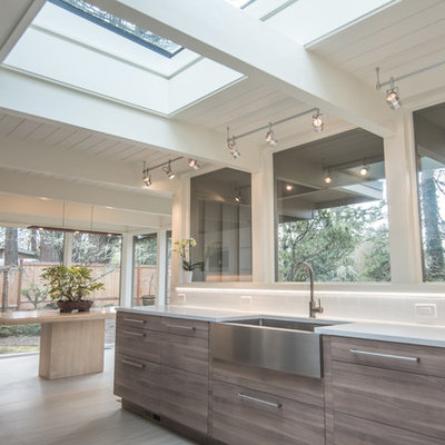 Example of a large 1950s galley porcelain tile and white floor eat-in kitchen design in Portland with a farmhouse sink, flat-panel cabinets, brown cabinets, quartz countertops, white backsplash, porcelain backsplash, stainless steel appliances, no island and white countertops