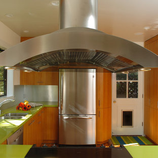 Inspiration for a contemporary u-shaped separate kitchen in San Francisco with stainless steel appliances, a double-bowl sink, flat-panel cabinets, medium wood cabinets, quartz benchtops, metallic splashback, metal splashback and green benchtop.