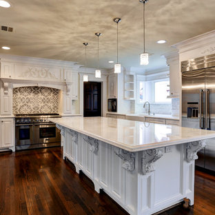 Mid-sized traditional open concept kitchen ideas - Mid-sized elegant galley dark wood floor open concept kitchen photo in Houston with a farmhouse sink, open cabinets, white cabinets, marble countertops, white backsplash, subway tile backsplash, paneled appliances and an island
