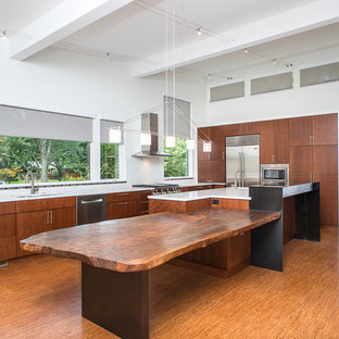 Photo of a large asian l-shaped eat-in kitchen in Detroit with a double-bowl sink, flat-panel cabinets, medium wood cabinets, quartzite benchtops, white splashback, stone slab splashback, stainless steel appliances, cork floors and with island.