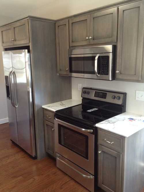 Kitchen with gray cabinets and laminate countertops design for Grey laminate kitchen cabinets