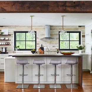 Contemporary kitchen appliance - Example of a trendy medium tone wood floor kitchen design in DC