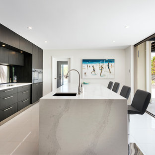 Contemporary single-wall kitchen in Perth with a submerged sink, flat-panel cabinets, dark wood cabinets and an island.
