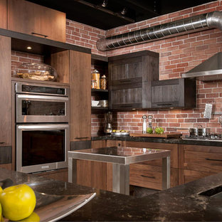 Inspiration for a large industrial l-shaped kitchen in Montreal with a double-bowl sink, quartzite benchtops, stainless steel appliances and with island.