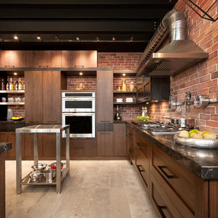 Large industrial l-shaped kitchen in Montreal with a double-bowl sink, quartzite benchtops, stainless steel appliances, with island and matchstick tile splashback.