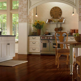 Large farmhouse eat-in kitchen designs - Inspiration for a large farmhouse l-shaped dark wood floor eat-in kitchen remodel in Philadelphia with recessed-panel cabinets, white cabinets, white backsplash, brick backsplash, stainless steel appliances and an island