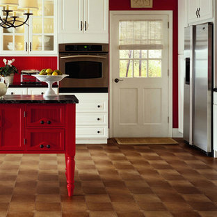 Farmhouse eat-in kitchen designs - Eat-in kitchen - cottage single-wall vinyl floor and brown floor eat-in kitchen idea in Orlando with beaded inset cabinets, white cabinets, red backsplash, stainless steel appliances and an island