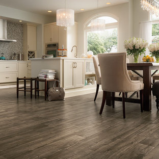 This is an example of a mid-sized traditional l-shaped eat-in kitchen in Other with beige cabinets, grey splashback, laminate floors, a peninsula, shaker cabinets, mosaic tile splashback and stainless steel appliances.