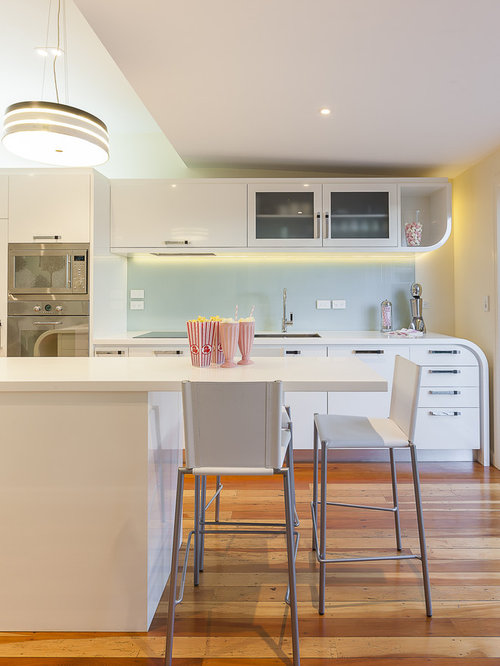 Trendy kitchen photo in Auckland with stainless steel appliances