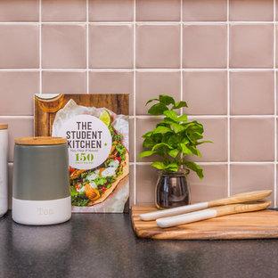 Ejemplo de cocina contemporánea, pequeña, con encimera de laminado, salpicadero rosa y salpicadero de azulejos de cerámica
