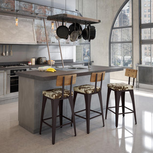 Inspiration for a large modern galley open plan kitchen in Toronto with an undermount sink, flat-panel cabinets, distressed cabinets, quartz benchtops, grey splashback, concrete floors, a peninsula, stone slab splashback and stainless steel appliances.